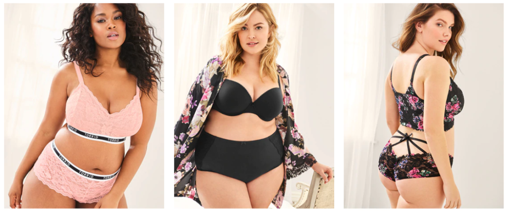 Torrid - alternative to Victoria's Secret for plus sizes. Three women, two white women and one woman of color, are shown on white backgrounds. One is wearing a pink bra and panty set; one is wearing a black bra and panty set with a floral kimono robe; and one is wearing a floral bra and panty set.