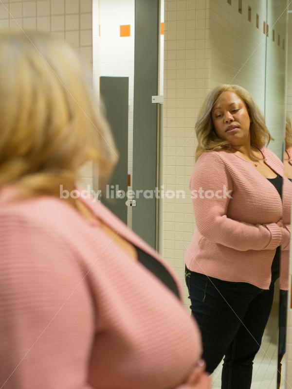 Body Image Stock Photo: Plus Size Woman in Office Bathroom Mirror - Body Liberation Photos