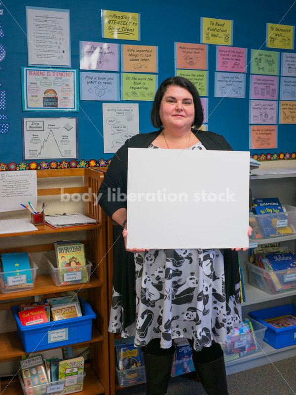 Body Positive Stock Image: Plus Size Teacher with Blank Sign for Your Text - Body Liberation Photos