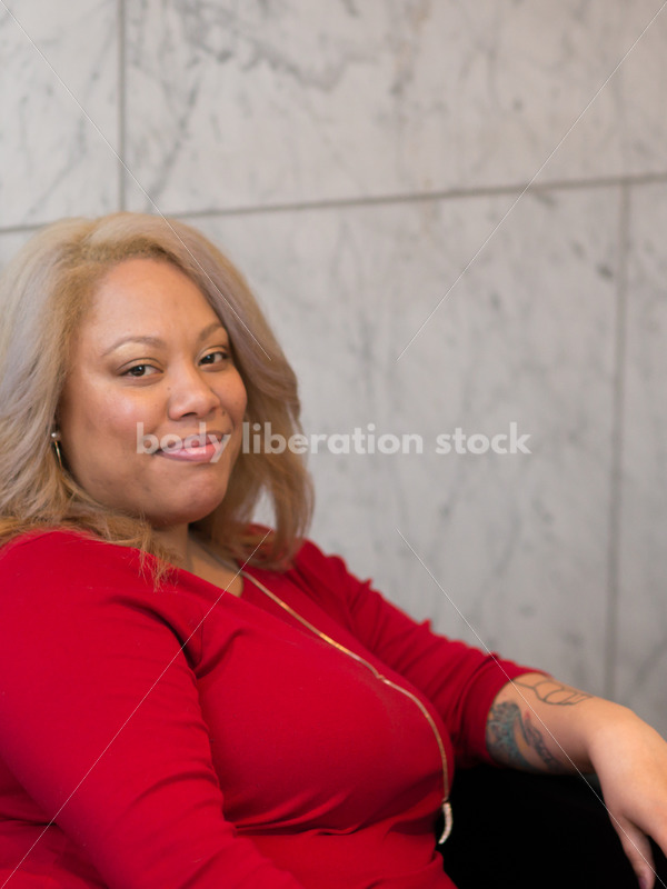 Business Stock Image: Plus Size Black Woman Sitting in Office Building Lobby - Body Liberation Photos