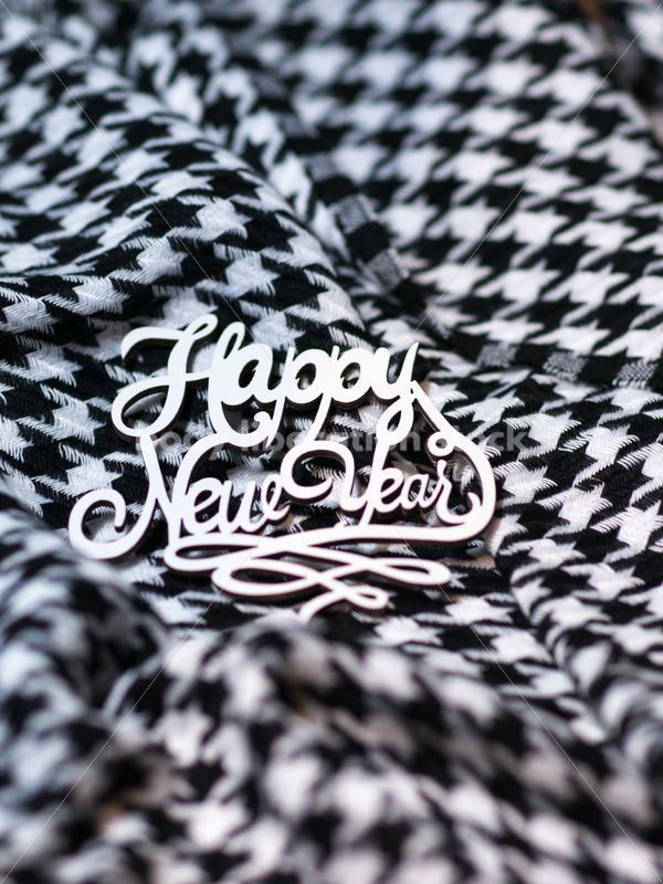 Christmas Stock Photo: Happy New Year on Houndstooth Scarf - Body Liberation Photos