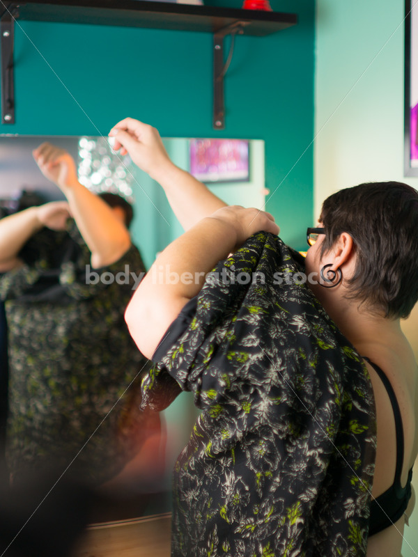 Clothing Retail Stock Photo: Plus Size Woman Tries on Clothes in Dressing Room - Body Liberation Photos