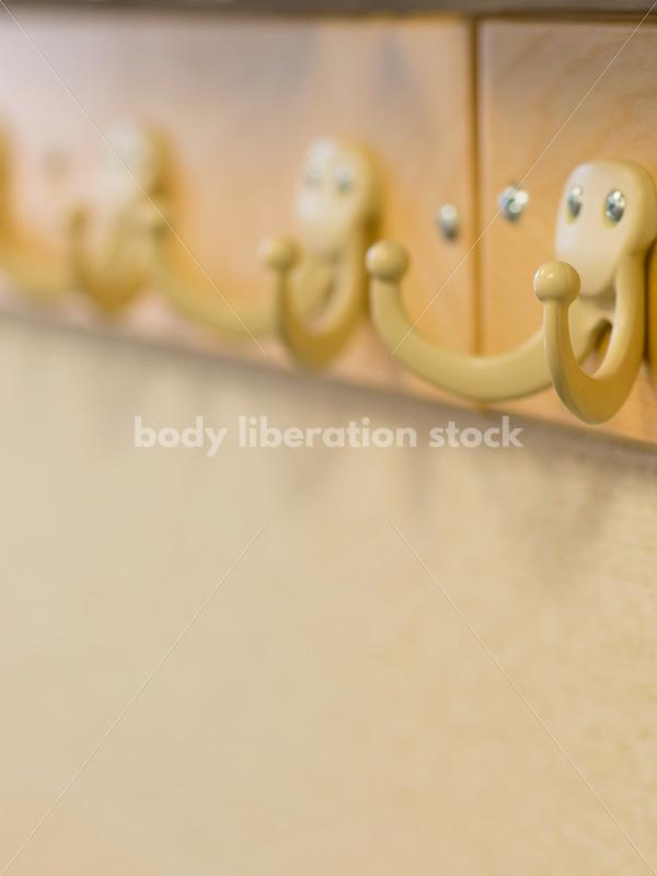 Education Stock Image: Classroom Coat Hooks and Whiteboard - Body Liberation Photos