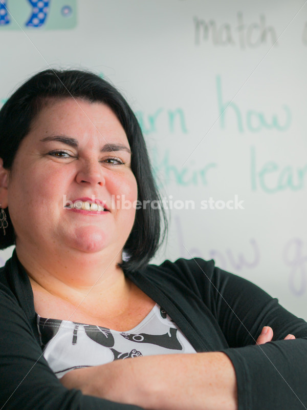 Education Stock Photo: Plus Size Elementary School Teacher with Crossed Arms - Body Liberation Photos