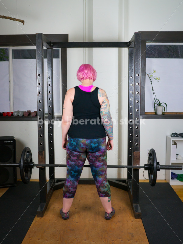 HAES Stock Photo: Female Weightlifter with Pink Hair Lifts Heavy Weight in Gym - Body Liberation Photos