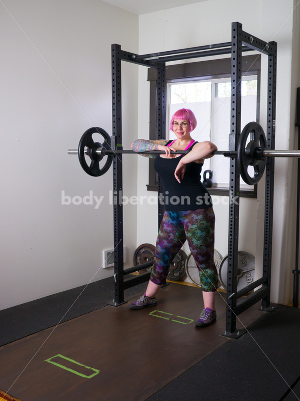 HAES Stock Photo: Female Weightlifter with Pink Hair Standing in Weight Lifting Gym - Body Liberation Photos