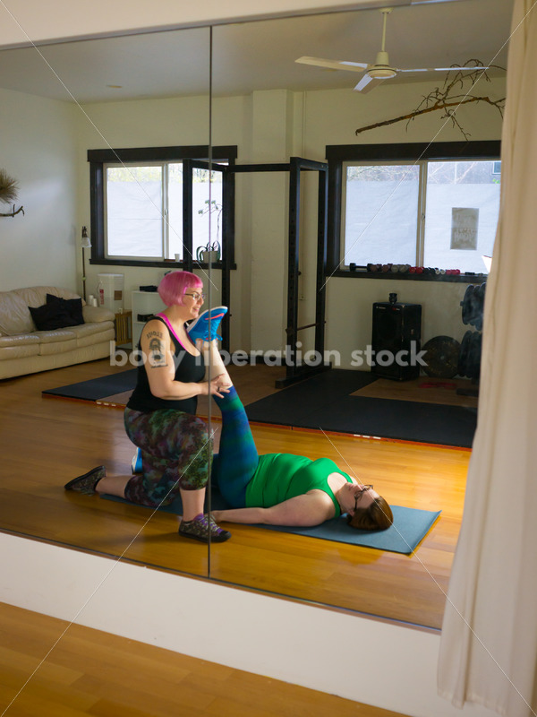 HAES Stock Photo: Personal Trainer Helps Client in Stretching Exercise - Body Liberation Photos
