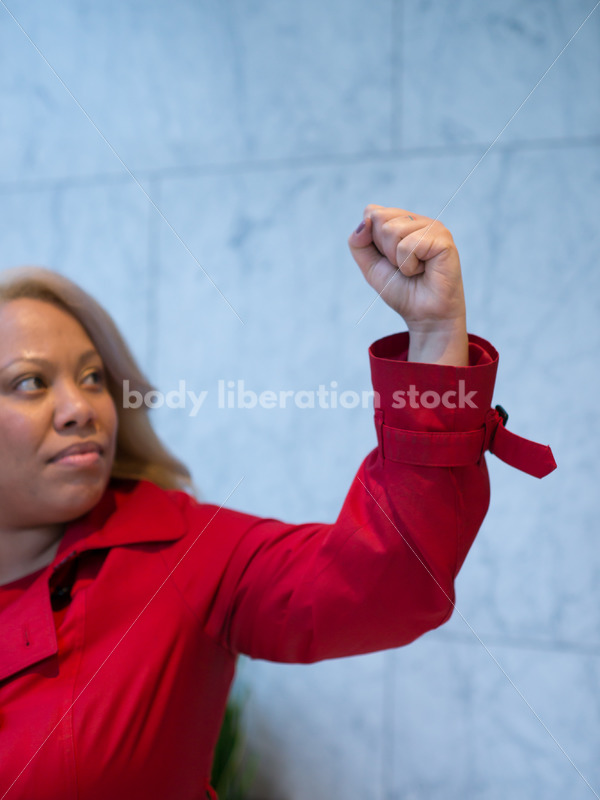 Human Rights & LGBT Stock Photo: African American Lesbian Woman Raising Fist for Protest - Body Liberation Photos