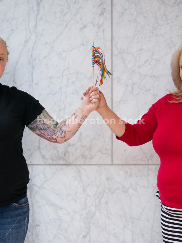 Human Rights & LGBT Stock Photo: Lesbian Couple with Rainbow Ribbon Flag - Body Liberation Photos