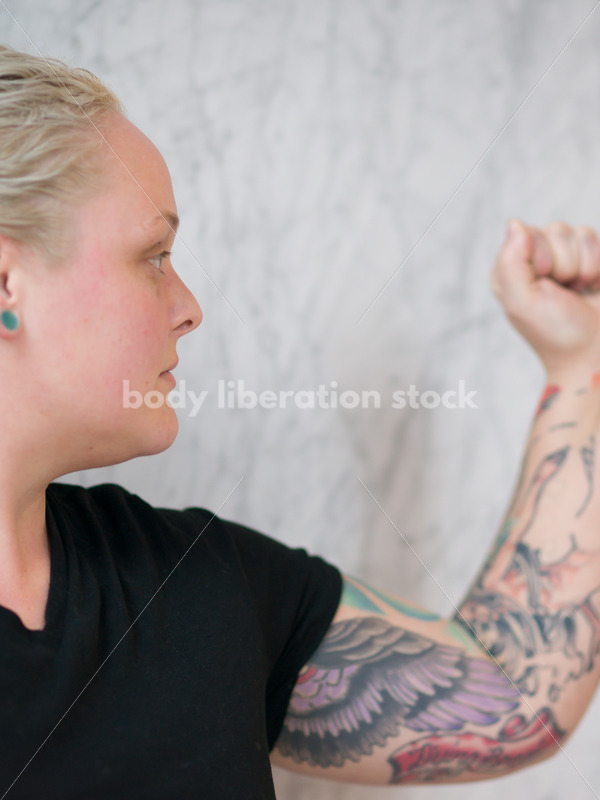 Human Rights & LGBT Stock Photo: Lesbian Woman Raising Fist for Protest - Body Liberation Photos