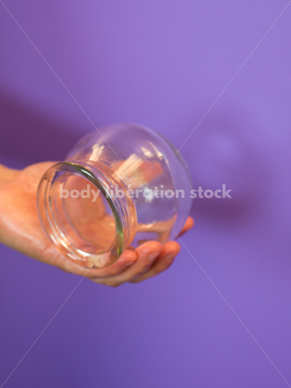 Immigration and Small Business Stock Image: Filipino Woman Holds Glass Massage Cup - Body Liberation Photos