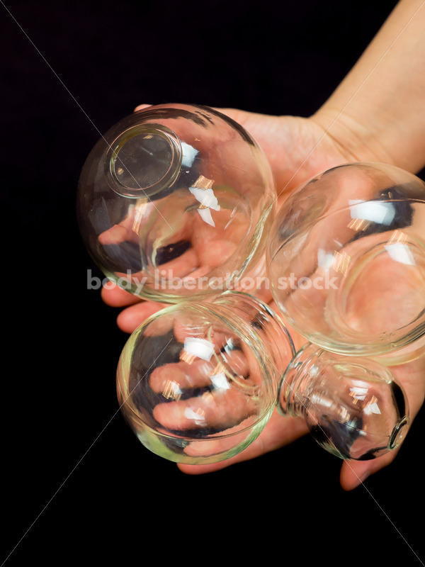 Immigration and Small Business Stock Image: Filipino Woman Holds Glass Massage Cups - Body Liberation Photos