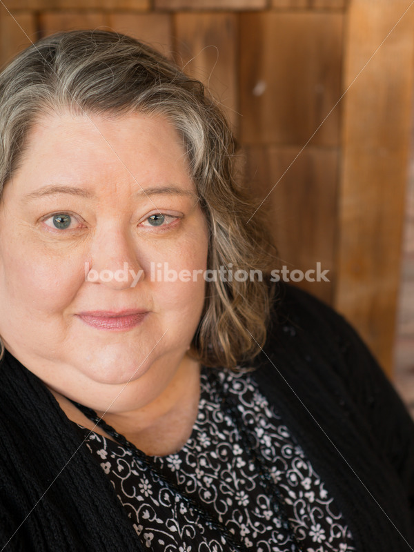 Plus Size Stock Photo: Woman in 50s with Rustic Wood Walls - Body Liberation Photos