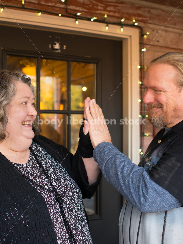 Retail Microstock Image: Older Couple Giving High Five - Body Liberation Photos