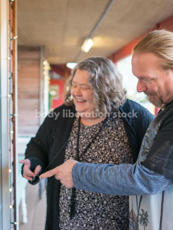 Retail Microstock Image: Older Couple Window Shopping - Body Liberation Photos