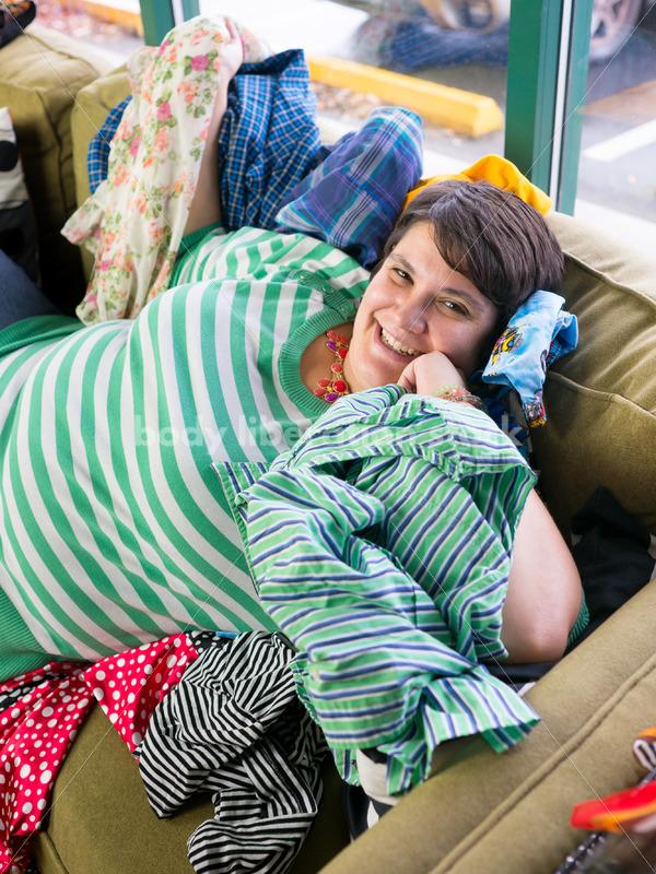 Retail Stock Photo: Plus Size Woman Shops for Clothing - Body Liberation Photos