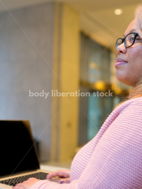 Royalty-Free Business Image: Black LGBT Woman Using Laptop Computer - Body Liberation Photos
