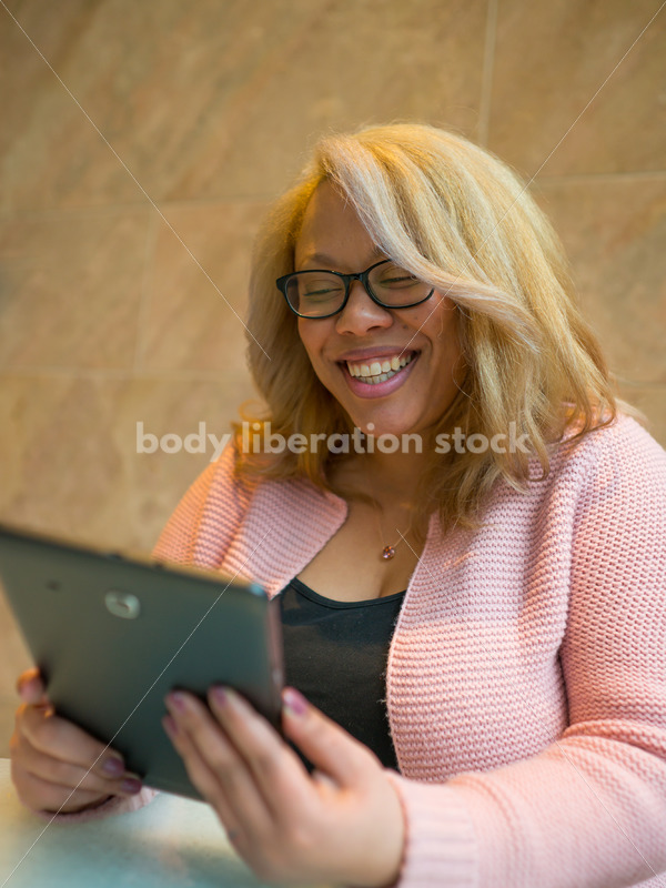 Royalty-Free Business Image: Black LGBT Woman Using Tablet Computer - Body Liberation Photos