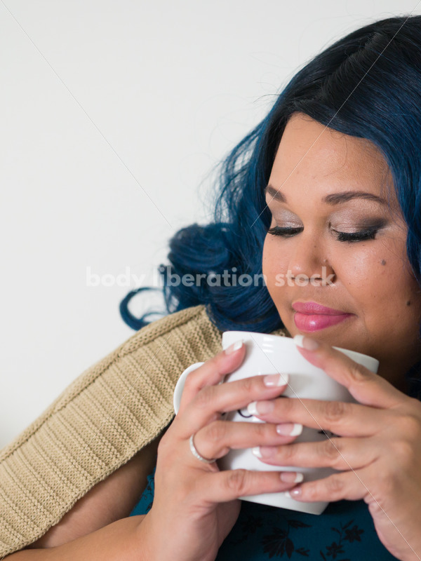 Royalty Free Stock Photo: Plus Size African American Woman Drinks Coffee on Bed - Body Liberation Photos