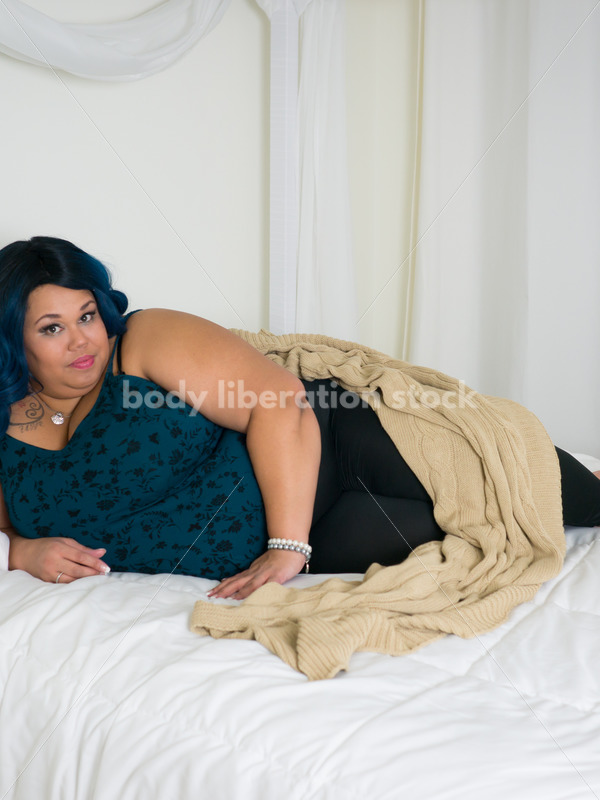 Royalty Free Stock Photo: Plus Size African American Woman on Bed - Body Liberation Photos