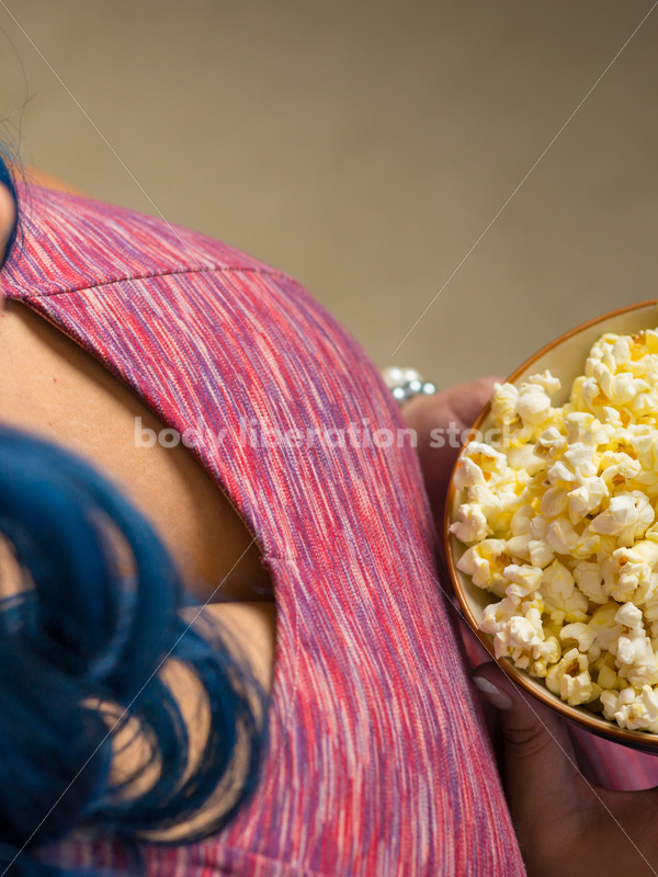 Royalty Free Stock Photo: Plus Size African American Woman with Bowl of Popcorn - Body Liberation Photos