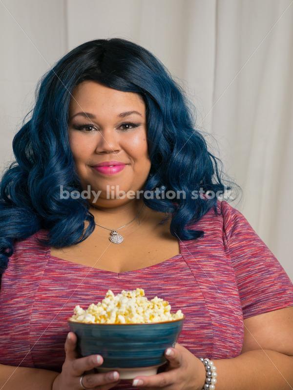 Royalty Free Stock Photo: Plus Size Black Woman with Bowl of Popcorn - Body Liberation Photos