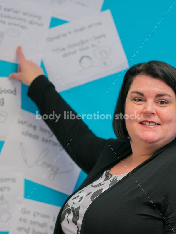 Royalty Free Stock Photo: Plus Size Elementary School Teacher in Classroom - Body Liberation Photos