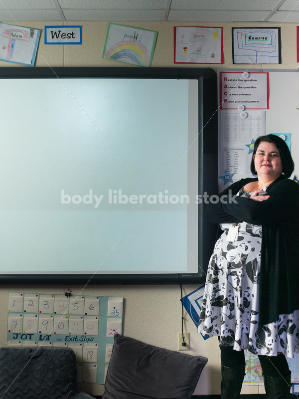 Royalty Free Stock Photo: Plus Size Teacher Writing on Smartboard - Body Liberation Photos