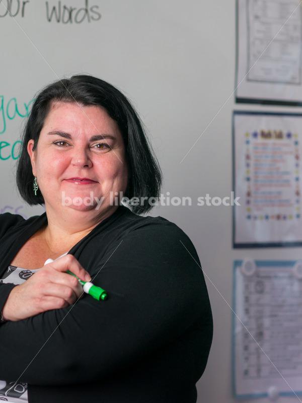 Royalty Free Stock Photo: Plus Size Teacher with Whiteboard - Body Liberation Photos