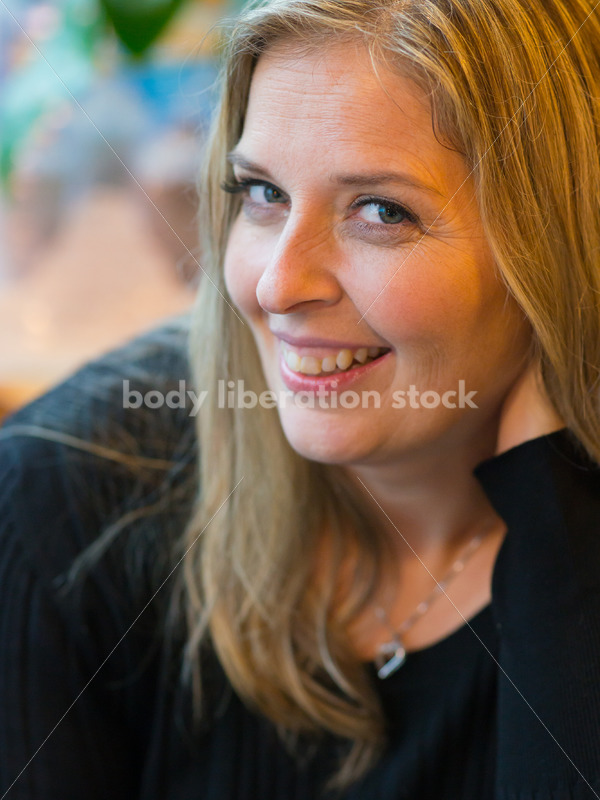 Royalty Free Stock Photo: Plus Size Woman Close-up in Coffee Shop - Body Liberation Photos