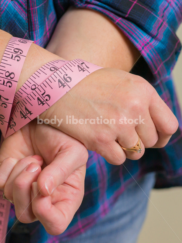 Royalty Free Stock Photo for Dieting Recovery: Woman Blinded by Tape Measure - Body Liberation Photos