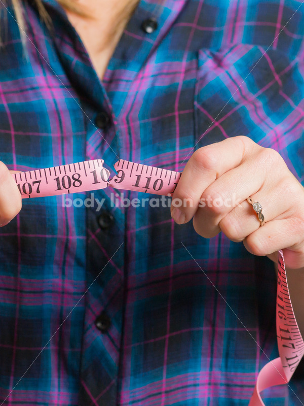 Royalty Free Stock Photo for Dieting Recovery: Woman Breaking Tape Measure - Body Liberation Photos
