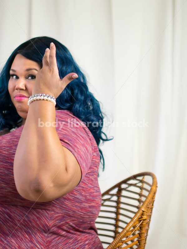 Royalty Free Stock Photo for Intuitive Eating: Black Woman Throws Head of Lettuce Over Shoulder - Body Liberation Photos