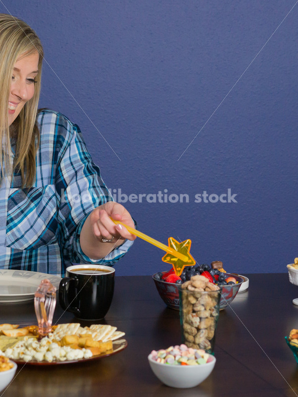 Royalty Free Stock Photo for Intuitive Eating: Plus Size Woman Chooses from Variety of Foods on Dining Table - Body Liberation Photos