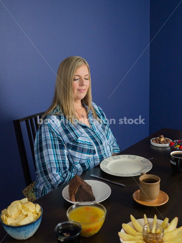 Royalty Free Stock Photo for Intuitive Eating: Plus Size Woman Considers Variety of Foods on Dining Table - Body Liberation Photos