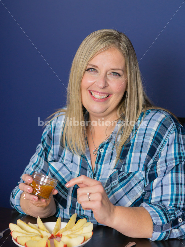 Royalty Free Stock Photo for Intuitive Eating: Plus Size Woman Eats Caramel Dip - Body Liberation Photos