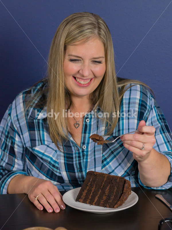 Royalty Free Stock Photo for Intuitive Eating: Plus Size Woman Eats Chocolate Cake, Nothing Bad Happens - Body Liberation Photos