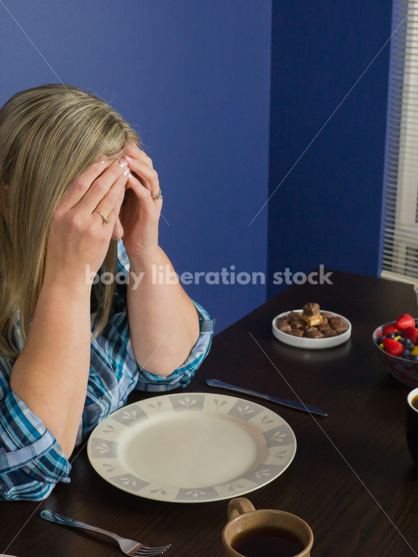 Royalty Free Stock Photo for Intuitive Eating: Plus Size Woman Overwhelmed by Variety of Foods on Dining Table - Body Liberation Photos
