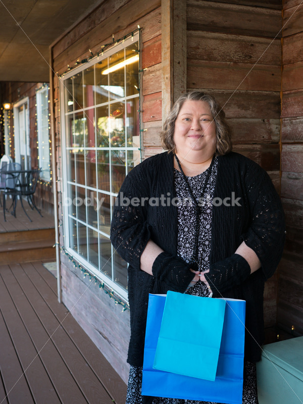 Shopping & Retail Stock Photo: Plus Size Woman with Shopping Bags Outside Small Boutique Store - Body Liberation Photos