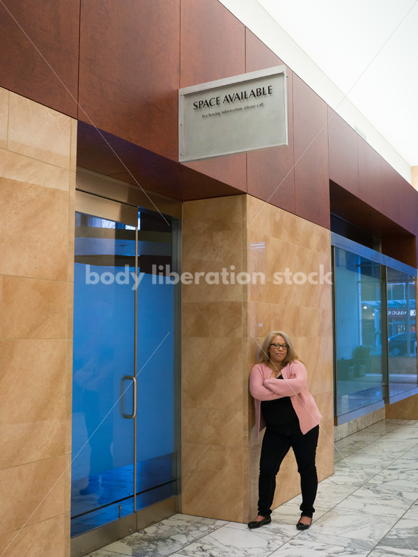 Small Business Stock Image: Black LGBT Businesswoman with Vacant Storefront - Body Liberation Photos