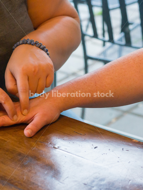 Stock Photo: Acupuncture Student Palpates to Locate Large Intestine Acupuncture Points - Body Liberation Photos