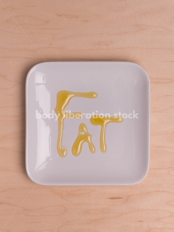 Stock Photo: Diet Recovery Concept FAT Spelled Out on Plate - Body Liberation Photos