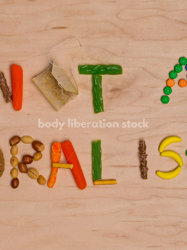 Stock Photo: Diet Recovery Concept NOT A MORAL ISSUE Spelled Out in Food - Body Liberation Photos