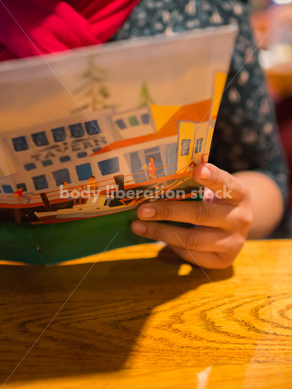 Stock Photo: Intuitive Eating – Asian American Woman with Menu - Body Liberation Photos