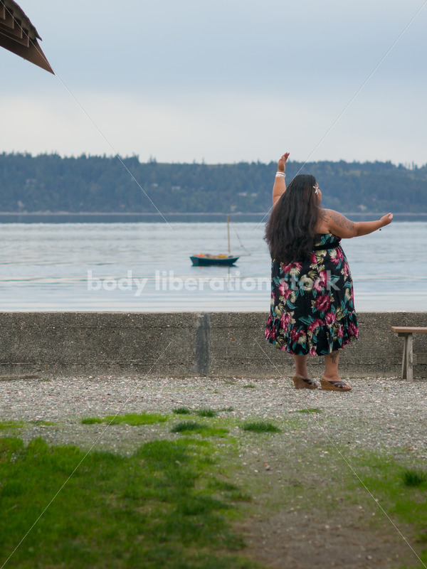 Stock Photo: Pacific Islander Woman Hula Dancing with Cabins on Evening Shore - Body Liberation Photos