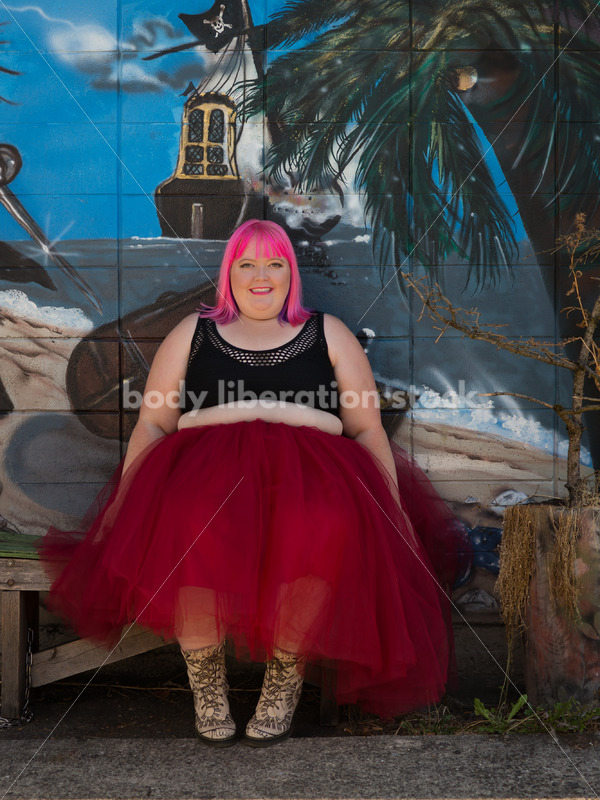 Stock Photo: Plus Size Woman with Pink Hair Seated in Tutu with Mural - Body Liberation Photos