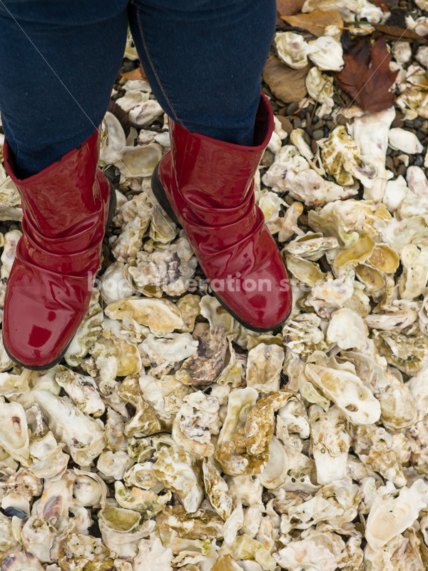 Stock Photo: Red Boots on Oyster Shell Shore - Body Liberation Photos