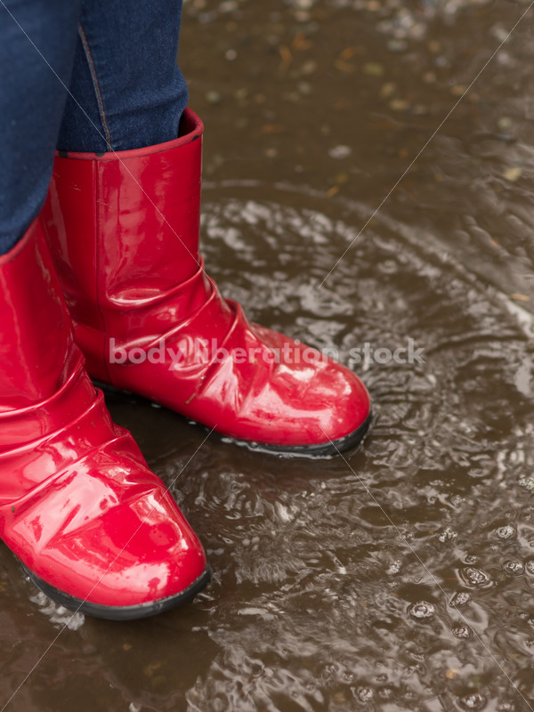 Stock Photo: Red Rain Boots and Pavement Puddle - Body Liberation Photos