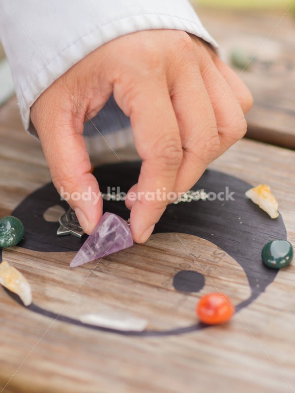 Stock Photo: Scrying, Clearing Gemstones and Pendulum Work with Yin and Yang and Asian American Hand - Body Liberation Photos