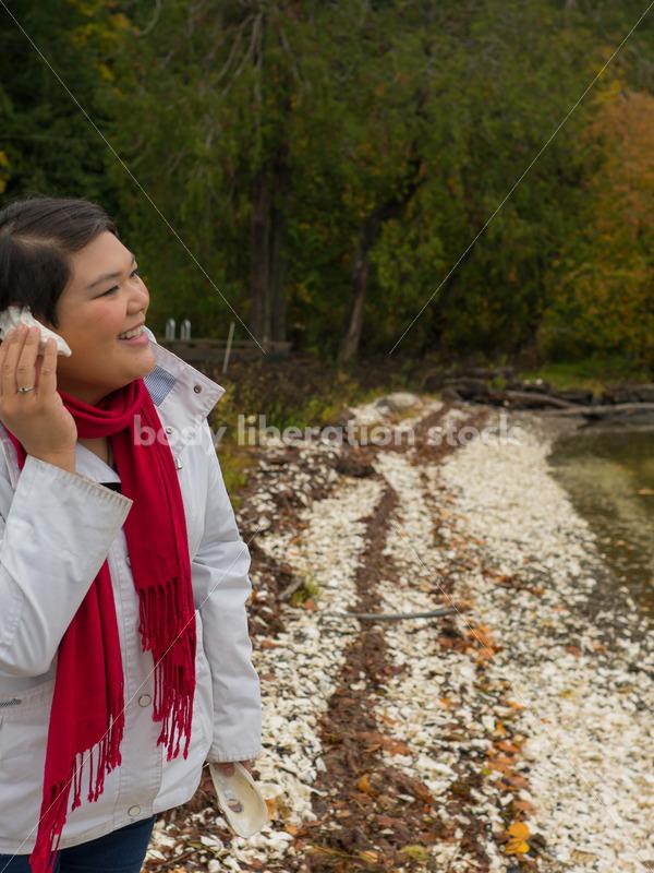 Stock Photo: Young Asian American Woman Explores Lake Shore - Body Liberation Photos